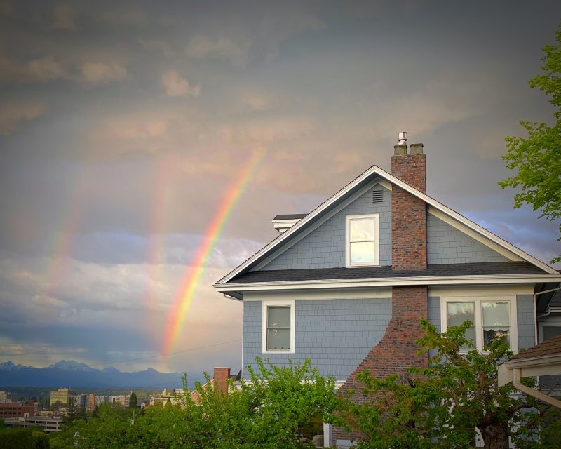 A house, and 3 oddly angled rainbows.